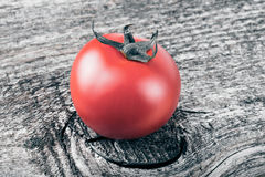 Fresh, red, ripe tomatoes on old grey wood background. Toned.  Stock Photography