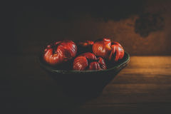 Fresh red rose apples. On wooden background in ceramic bowl Royalty Free Stock Image