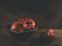 Fresh red rose apples. On wooden background in ceramic bowl Stock Image