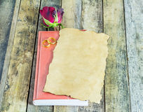 Fresh red rose,gold ring and old paper on notebook Stock Photography