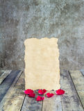 Fresh red rose and old paper on a wooden background. Holidays romantic background Stock Images