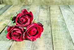 Fresh red rose on a wooden background. romantic background Stock Images