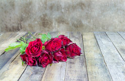 Fresh red rose on wooden background. Stock Photo