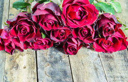 Fresh red rose on wooden background Royalty Free Stock Photos