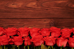 Fresh red roses with empty wooden copyspace Royalty Free Stock Images