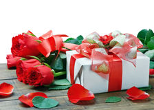 Fresh red roses and gift Royalty Free Stock Photography
