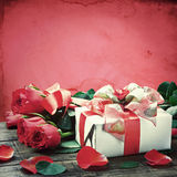 Fresh red roses and gift box Stock Images