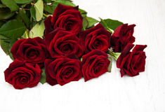 Fresh Red roses. On a old wooden background Royalty Free Stock Photo