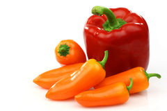 A fresh red and some orange peppers Royalty Free Stock Photography
