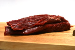 Fresh red steak. Uncooked fresh red steak on plate Stock Photos