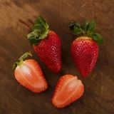 Fresh Red Strawberries on Brown Wooden Background Stock Photo