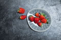 Fresh red strawberries on ceramic gray plate Royalty Free Stock Images