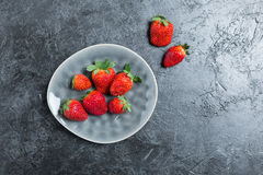 Fresh red strawberries on ceramic gray plate Stock Photos