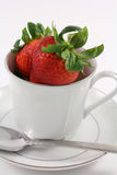 Fresh Red Strawberries inside a White Teacup Royalty Free Stock Photography