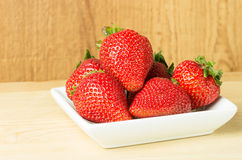 Fresh Red Strawberries on white plate Stock Photography