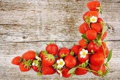 Fresh, red strawberries on wooden board background Stock Photography