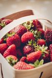 Fresh red strawberries in the wooden box stock image