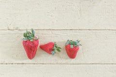 Fresh Strawberries on Yellow Background Stock Image