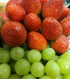 Fresh red strawberry and green grape Royalty Free Stock Image