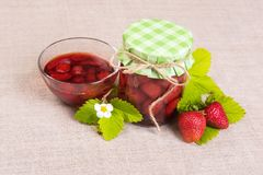 Fresh red strawberry and jam on textile background Stock Photography
