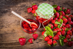 Fresh red strawberry and jam on wood background Stock Photography