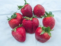 Fresh Red Strawberry. Strawberries on white background with green Stock Images