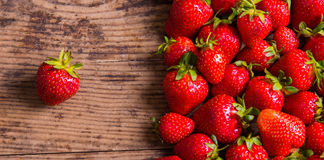 Fresh red strawberry on wood background Royalty Free Stock Image