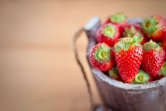 Strawberry in wooden bucket copy space Royalty Free Stock Image