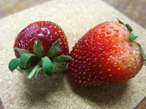 Fresh red strawberry on wooden plate Royalty Free Stock Photo