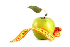 Fresh red tasty apple with measuring tape Stock Photos