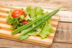 Fresh red tomato, green onions, lettuce, parsley Royalty Free Stock Photo