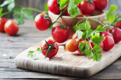 Fresh red tomato with green parsley Royalty Free Stock Image