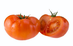 Fresh red tomato and a half. Fresh red tomato and a half with water drops isolated on a white background Stock Photos