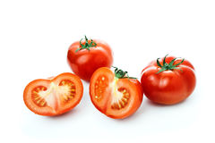 Fresh red Tomato and half slices on white background Stock Photos