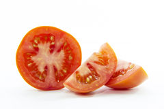 Fresh red tomato pieces sliced ingredient Royalty Free Stock Image