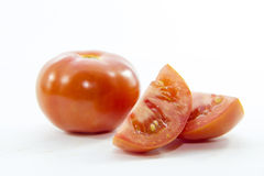 Fresh red tomato pieces sliced with raw material Stock Photo