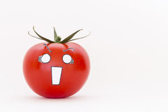 Fresh red tomato with scared face Stock Photos
