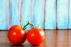 Fresh red tomato on wooden table Stock Photo