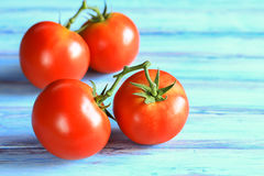 Fresh red tomato on wooden table Royalty Free Stock Images