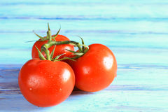 Fresh red tomato on wooden table Stock Images