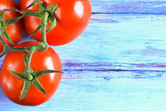 Fresh red tomato on wooden table Royalty Free Stock Photography