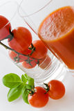 Fresh red tomatoes with basil leaf and juice Royalty Free Stock Image