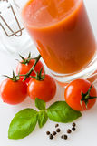 Fresh red tomatoes with basil leaf and juice Stock Photos