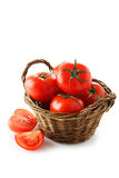 Fresh red tomatoes in basket isolated on a white Stock Photography