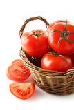 Fresh red tomatoes in basket isolated on a white Royalty Free Stock Images