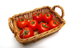 Fresh Red Tomatoes in a Basket over White Stock Photos
