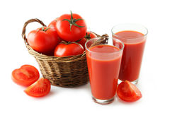 Fresh red tomatoes in basket and tomato juice in glass isolated on a white Royalty Free Stock Photos