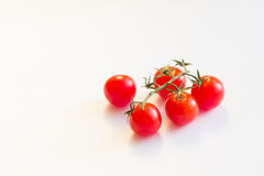 Fresh red tomatoes. Cooking, healthy or vegetarian eating concept. Fresh red tomatoes on white background. Cooking, healthy or vegetarian eating concept Royalty Free Stock Photos