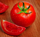 Fresh red tomatoes on a cutting board Stock Photography