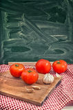 Red tomato and garlic Royalty Free Stock Photos